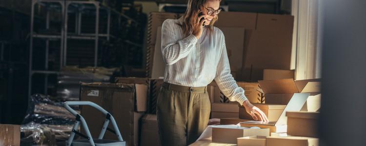 female online seller confirming orders