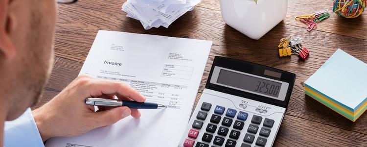 Accountant calculating tax using a calculator